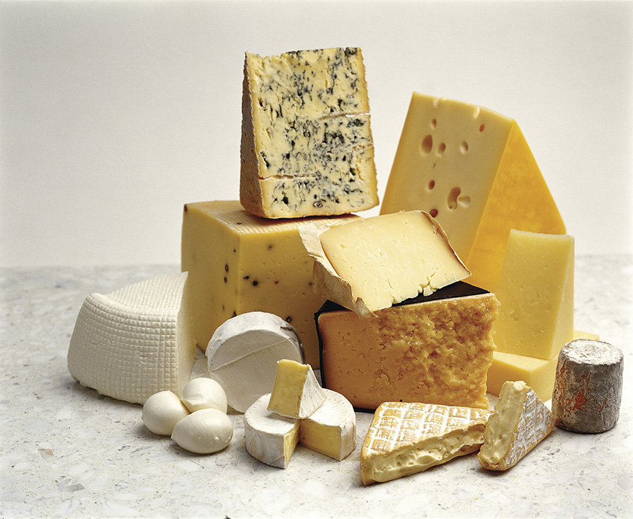 Pile of cheese varieties