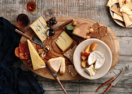 Beautiful wooden platter laden with cheese and fruit